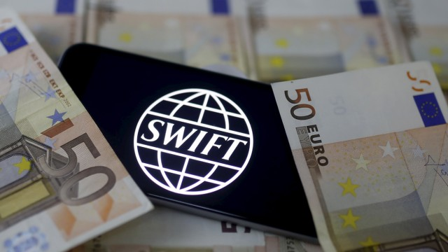Swift code bank logo is displayed on an iPhone 6s on top of Euro banknotes in this picture illustration made in Zenica