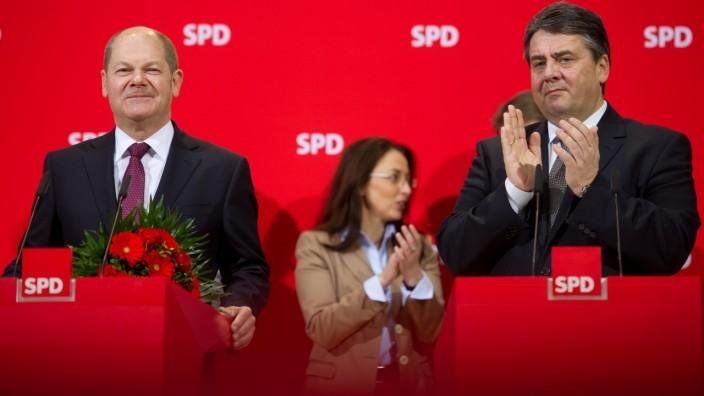 Leader of SPD Gabriel congratulates SPD top candidate Hamburg Mayor Scholz at SPD headquarters in Berlin