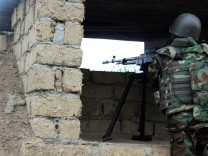 Azeri serviceman aims his weapon at frontline with self-defense army of Nagorno-Karabakh in Azerbaijan