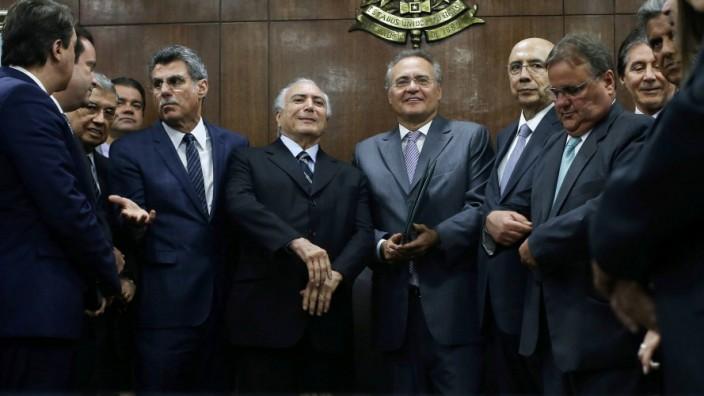 Brazil's interim President Temer attends a meeting with Brazil's Senate President Calheiros as the Planning Minister Juca in Brasilia