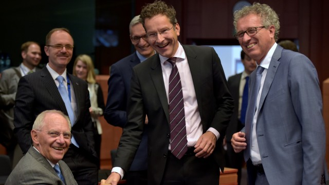 Germany's Finance Minister Schauble chats with Eurogroup President Dijsselbloem and Luxembourg's Finance Minister Gramegna during a Euro zone finance ministers meeting in Brussels