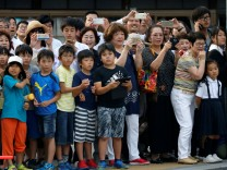 Hiroshima residents watch motorcade carrying U.S. President Obam in Hiroshima, Japan