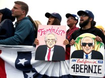 Supporters cheer for U.S. Democratic presidential candidate Bernie Sanders as he speaks at a campaign rally in Santa Barbara
