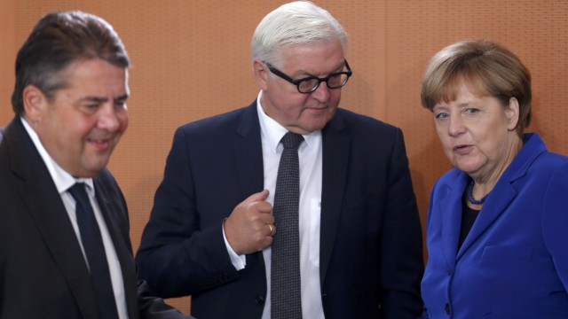 German Economy Minister Gabriel, German Minister for Foreign Affairs Steinmeier and German Chancellor Merkel arrive for the weekly cabinet meeting at the Chancellery in Berlin