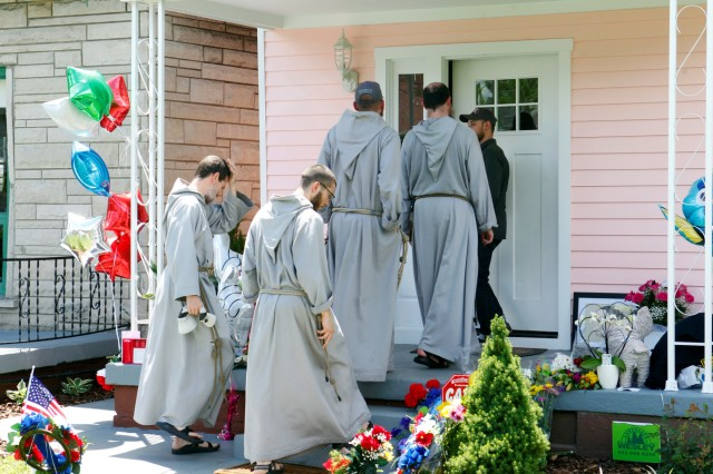 Franciscan Friars of the Renewal from New York pay their respect to Muhammad Ali, the former world heavyweight boxing champion after he died at the age of 74 on Friday at Ali's childhood home in Louisville