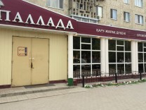 Flowers are placed outside firearms shop after suspected Islamist militant attack in Aktobe
