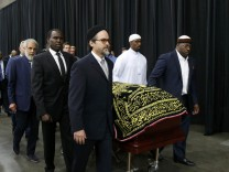 The coffin of late boxing champion Muhammad Ali arrives for a jenazah, an Islamic funeral prayer, in Louisville