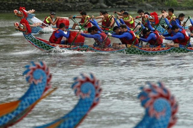 Participants compete during a race to mark Duan Wu, or Dragon Boat Festival, in Taipei