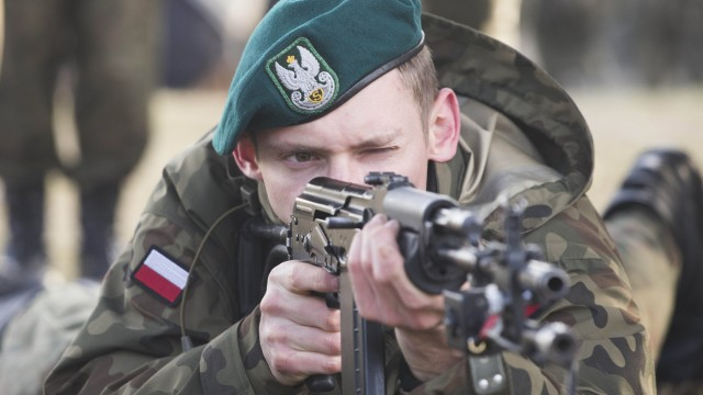 Jan 30 2016 Warsaw Poland Member of the paramilitary group teaches shooting in the military u