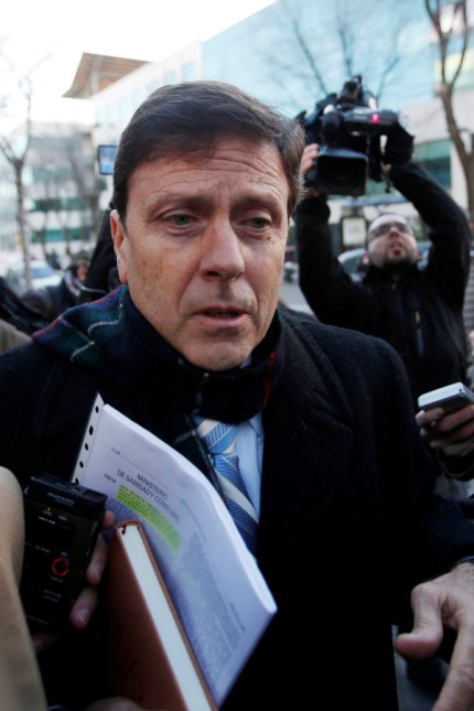 Spanish doctor Eufemiano Fuentes enters the courthouse on the first day of the Operacion Puerto trial in Madrid, Spain