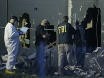 FBI investigators work at the scene of a mass shooting at the Pulse gay night club in Orlando, Florida