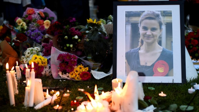 Mourners leave candles in memory of murdered Labour Party MP Jo Cox, in London