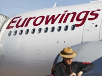 A man walks to board an Airbus A330 belonging to Lufthansa's low-cost brand Eurowings ahead of Eurowings' first long-haul flight to Havana, Cuba, at Cologne-Bonn airport