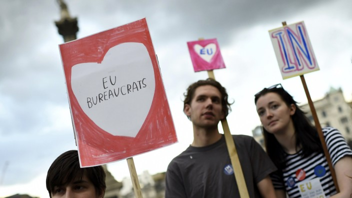 People hold signs in Trafalgar Square during a 'Yes to Europe' rally for young people, in central London