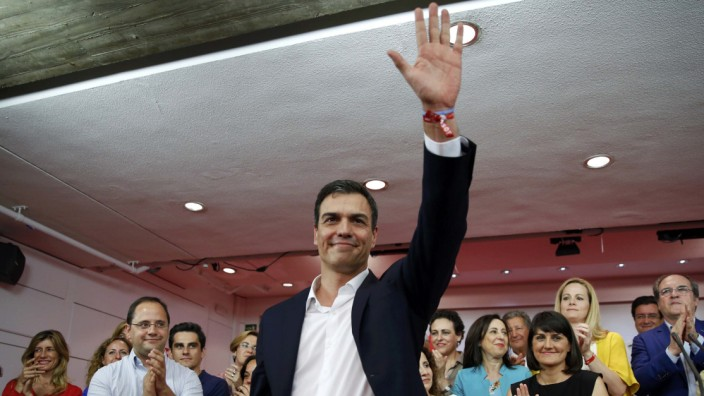 Spain's Socialist Party (PSOE) leader Pedro Sanchez  waves to supporters after results were announced in Spain's general election in Madrid