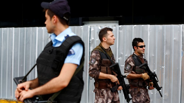 A police officer stands guard as the members of police special forces patrol at Ataturk airport in Istanbul