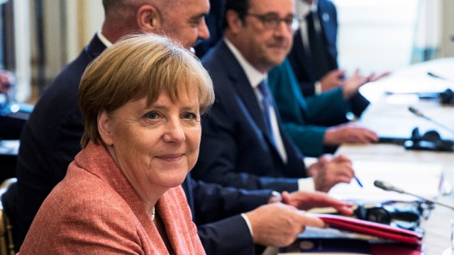 Delegations from the Balkans sit around a table around French President Francois Hollande and German Chancellor Angela Merkel as they attend the Western Balkans summit at the Elysee Palace in Paris