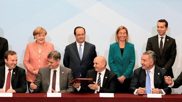 French President Francois Hollande attends a signing agreement during a Western Balkans summit at the Elysee Palace in Paris