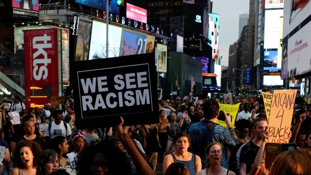 People take part in a protest against the killings of Alton Sterling and Philando Castile during a march through Times Square in New York
