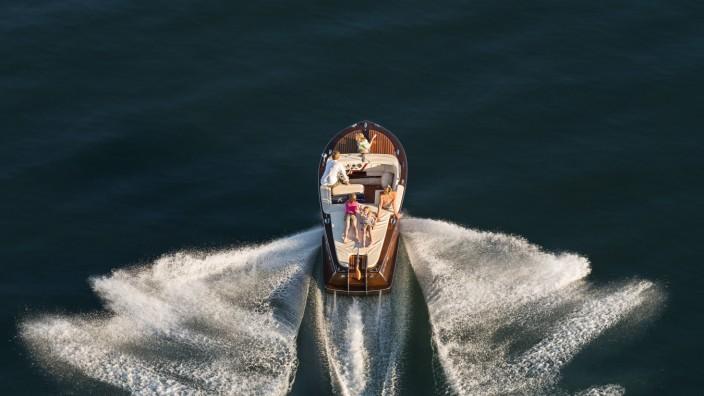 Germany Baden Wurttenberg Lake Constance Family on wooden motorboat model released property relea