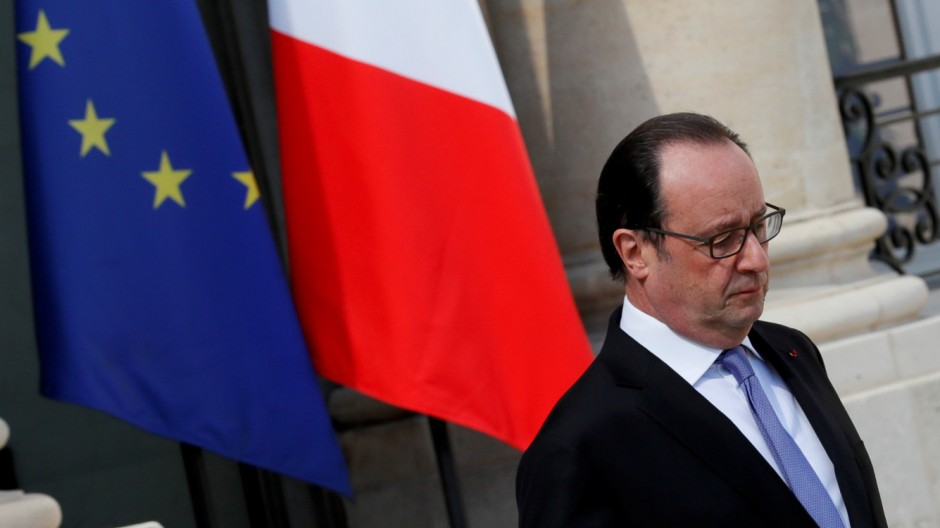 French President Francois Hollande leaves the Elysee Palace in Paris