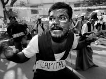 An Indian activist mimicks capitalism's hunger toward workers