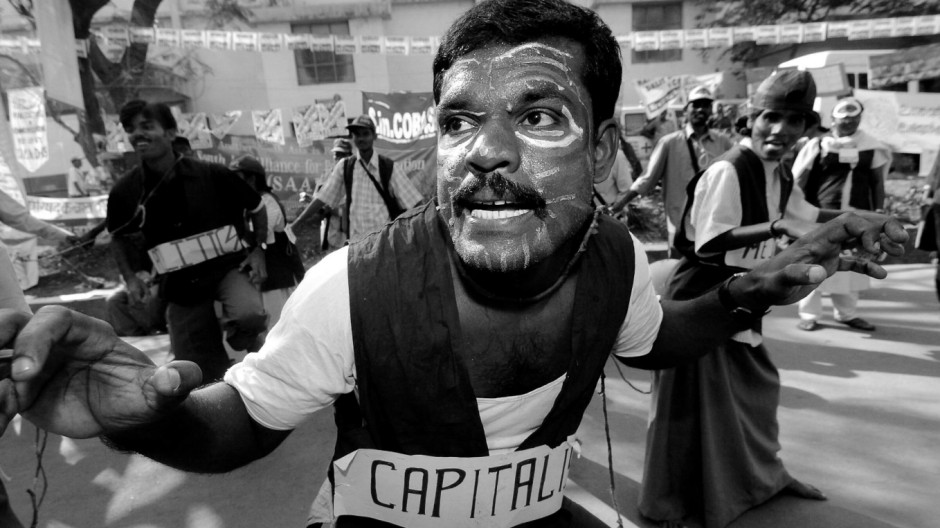 An Indian activist mimicks capitalism's hunger toward workers