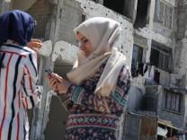 July 14 2016 Gaza Gaza strip Palestine Girls in Gaza on 14 July 2016 playing Pokemon game sea