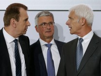 Blessing, Volkswagen Group Board Member, Audi Chief Executive Officer Stadler and Volkswagen CEO Mueller chat after the annual news conference in Wolfsburg