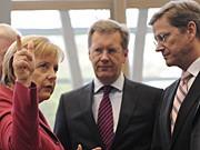 Merkel Wulff Westerwelle dpa
