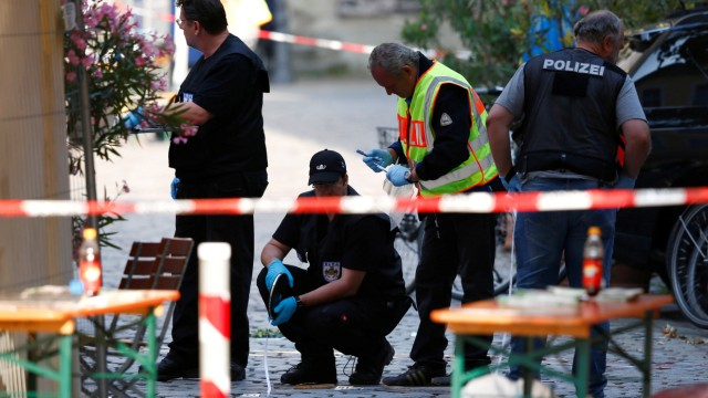 Police secure the area after an explosion in Ansbach