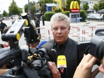 Munich Mayor Dieter Reiter speaks to media during visit to shooting rampage scene in Munich