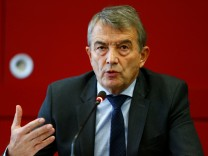 Wolfgang Niersbach, president of the German Football Association addresses a news conference at the DFB headquarters in Frankfurt