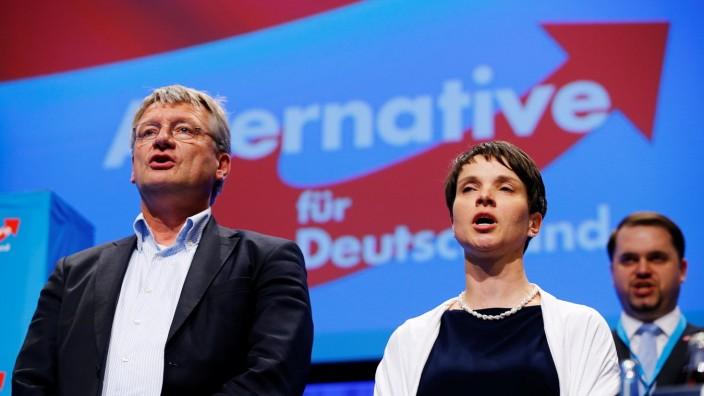 Petry, chairwoman of the anti-immigration party Alternative for Germany (AfD), and AfD leader Meuthen sing at the end of the second day of the AfD congress in Stuttgart