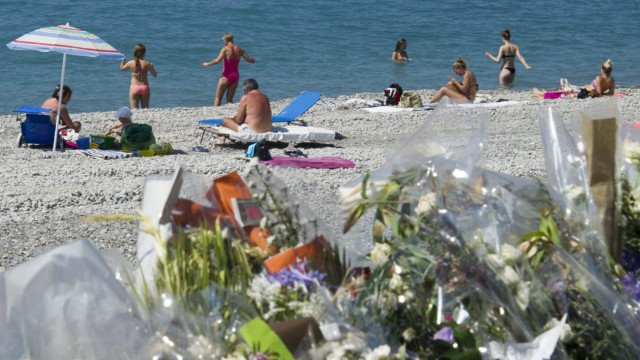People enjoy the beach on July 17, 2016, in front of the Promenad