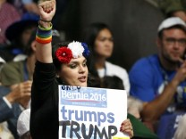 A Bernie Sanders supporter raises her fist during the Democratic National Convention in Philadelphia