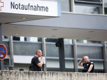 Police stand outside the university clinic in Steglitz, a southwestern district of Berlin