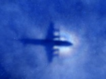 File photo of shadow of a Royal New Zealand Air Force (RNZAF) P3 Orion maritime search aircraft on low-level clouds as it flies over the southern Indian Ocean looking for missing Malaysian Airlines flight MH370