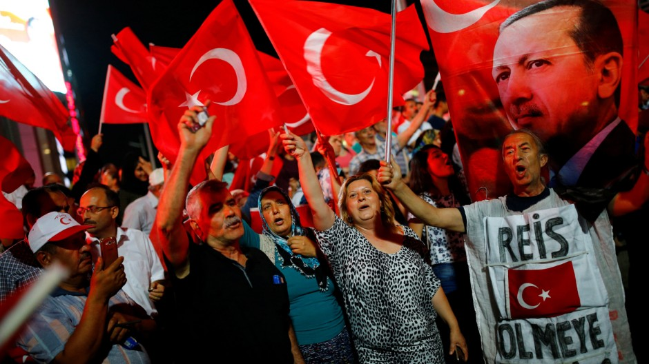 People shout slogans and wave Turkish national flags as they have gathered in solidarity night after night since the July 15 coup attempt in central Ankara