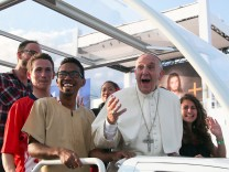 Pope Francis reacts as he arrives with youth to lead a Prayer Vigil at the Campus Misericordiae during World Youth Day in Brzegi near Krakow