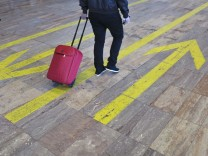 A passenger rolls a suitcase in Barcelona's El Prat airport
