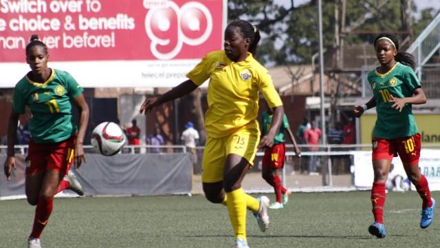 Zimbabwe senior national women soccer team player Rudo Neshamba C vies for the ball during the sec; Rudo Neshamba