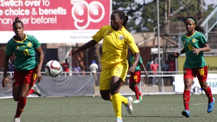 Zimbabwe senior national women soccer team player Rudo Neshamba C vies for the ball during the sec; Rudo Neshamba