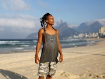 The Wider Image: Cariocas reflect on the Olympics