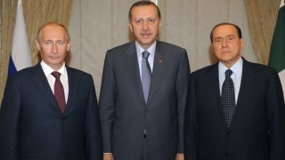 Turkish Prime Minister Recep Tayyip Erdogan is seen with his counterparts Vladimir Putin of Russia and Silvio Berlusconi of Italy during a meeting in Ankara