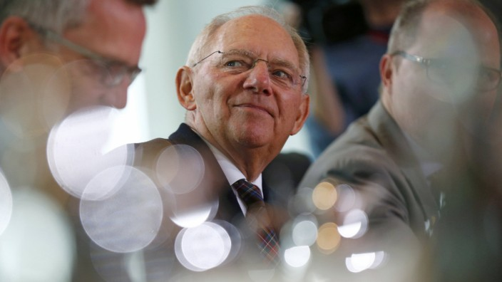 German Finance Minister Schaeuble arrives for the cabinet meeting at the Chancellery in Berlin