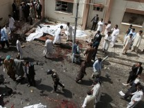 An overview of the scene of a bomb blast outside a hospital in Quetta