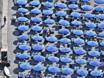 Tourists enjoy the beach in 'Quercianella' Livorno
