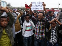 Protesters chant slogans during a demonstration over what they say is unfair distribution of wealth in the country at Meskel Square in Ethiopia's capital Addis Ababa