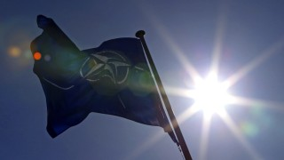 A NATO flag flies at the Alliance headquarters in Brussels during a NATO ambassadors meeting on the situation in Ukraine and the Crimea region